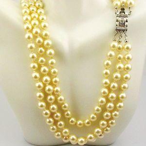 Jackie Kennedy Triple Strand Simulated Pearls!